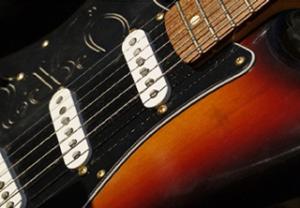 som-guitar-pickup1-crop-u114640-300x208